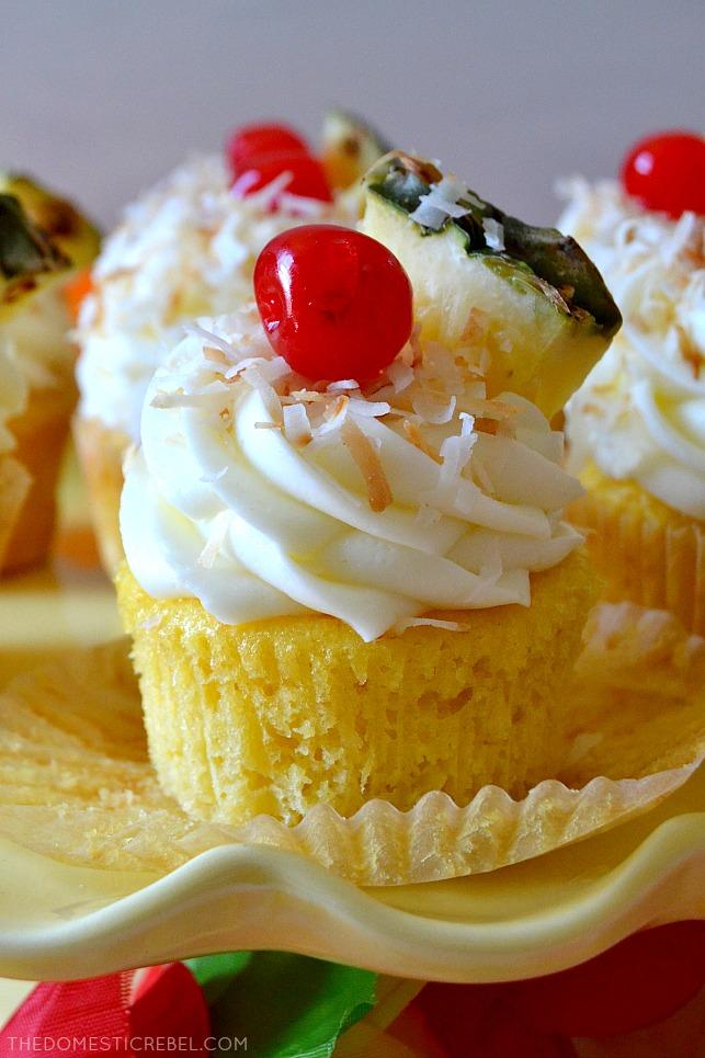 pina colada cupcake up close on yellow stand