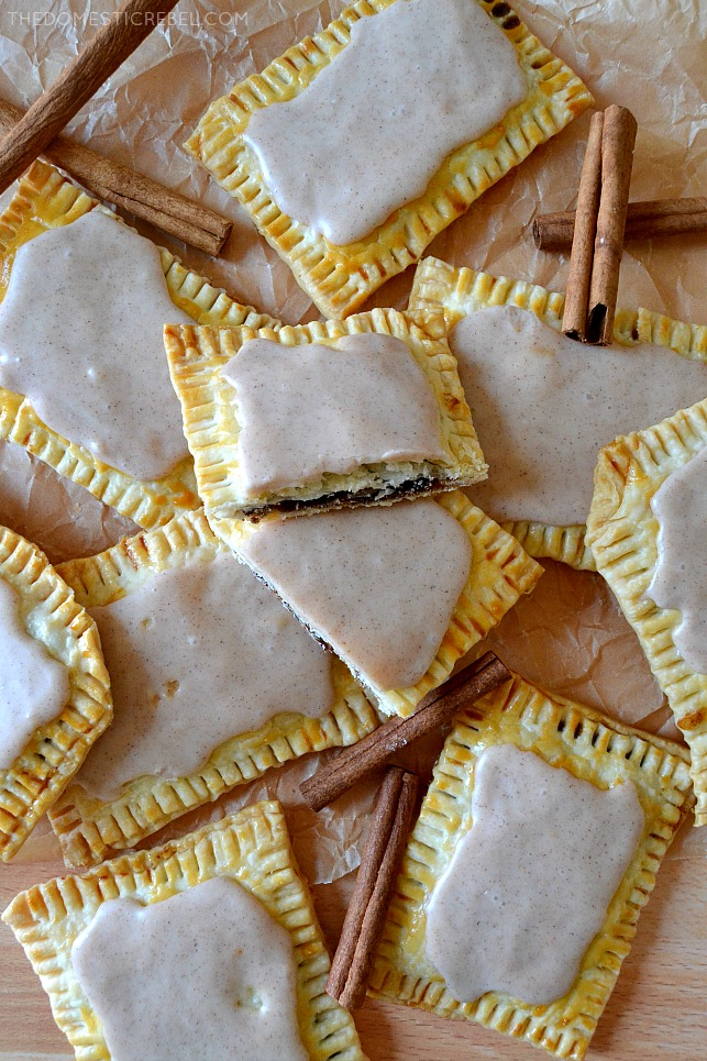 brown sugar cinnamon poptarts arranged on parchment with cinnamon sticks
