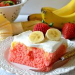 This Strawberry Banana Poke Cake is sweet, refreshing, fruity, easy and DELICIOUS! Made with a moist strawberry cake, banana pudding and fresh whipped cream for the ultimate, simple poke cake!!