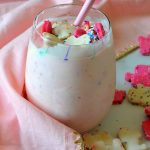 Circus Animal Cookie Blizzard in glass with pink towel and cookies