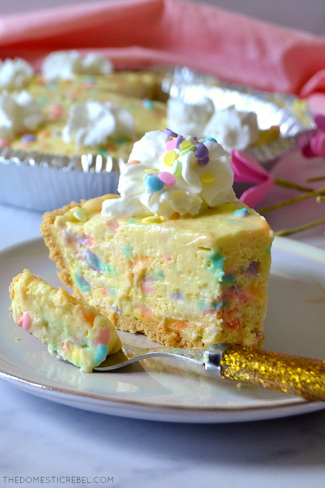 No-Bake Cake Batter Pie on a plate with a fork and pink cloth in background