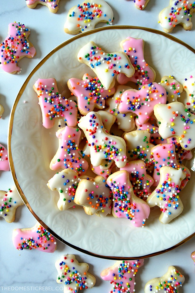 circus animal cookies arranged on a plate and marble