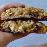 author holding split open oatmeal raisin cookie