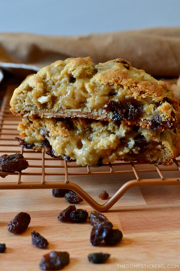 photo of stacked split open oatmeal raisin cookies on baking rack with raisins