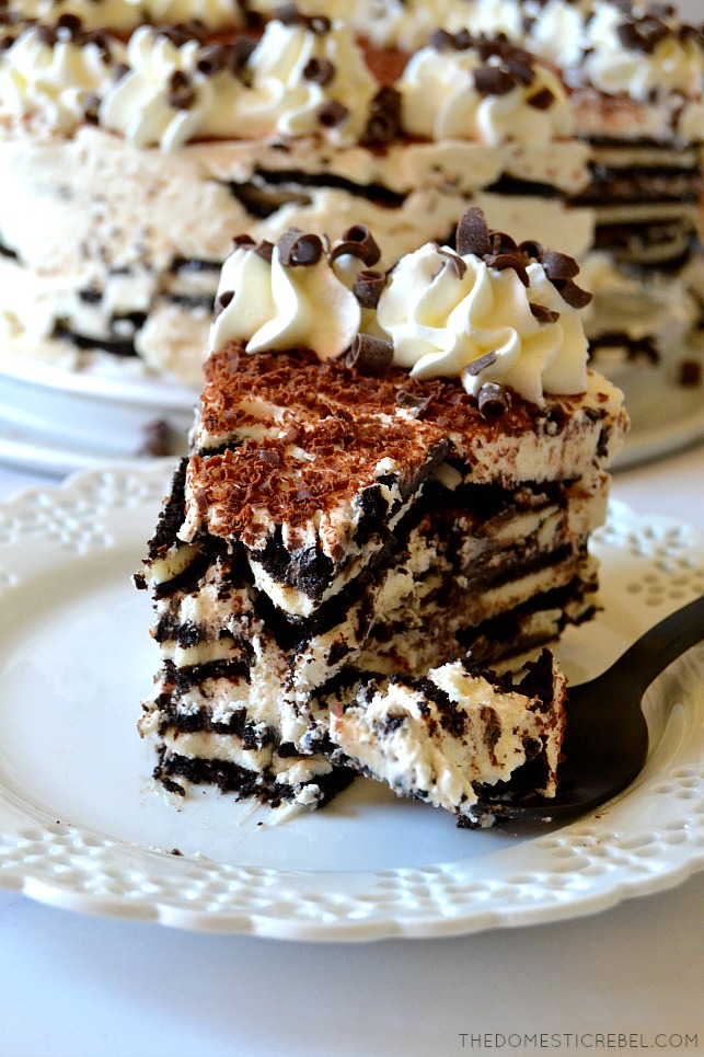 Photo of tiramisu oreo icebox cake slice on white plate with fork and bite missing
