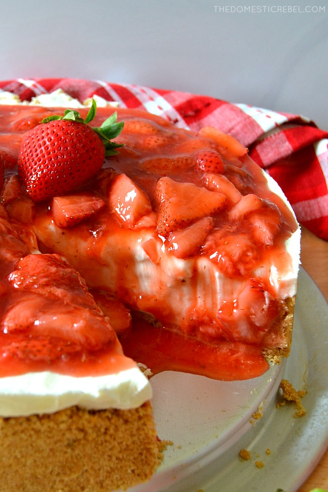 Strawberry Cheesecake on pie pan with checkered towel in background