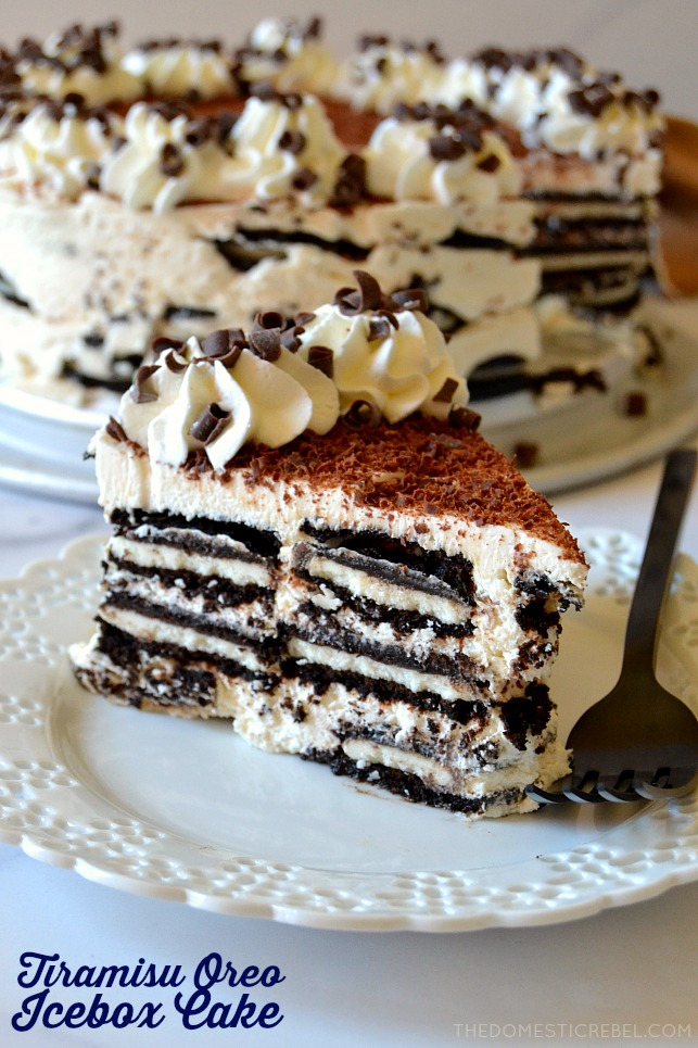 photo of tiramisu oreo icebox cake slice on white plate with black fork and cake in background