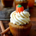 Pumpkin Cupcake on wooden board with cinnamon sticks