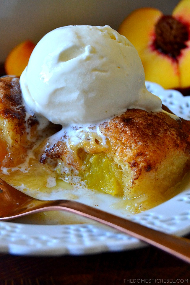 Peach Dumplings on white plate with bite missing