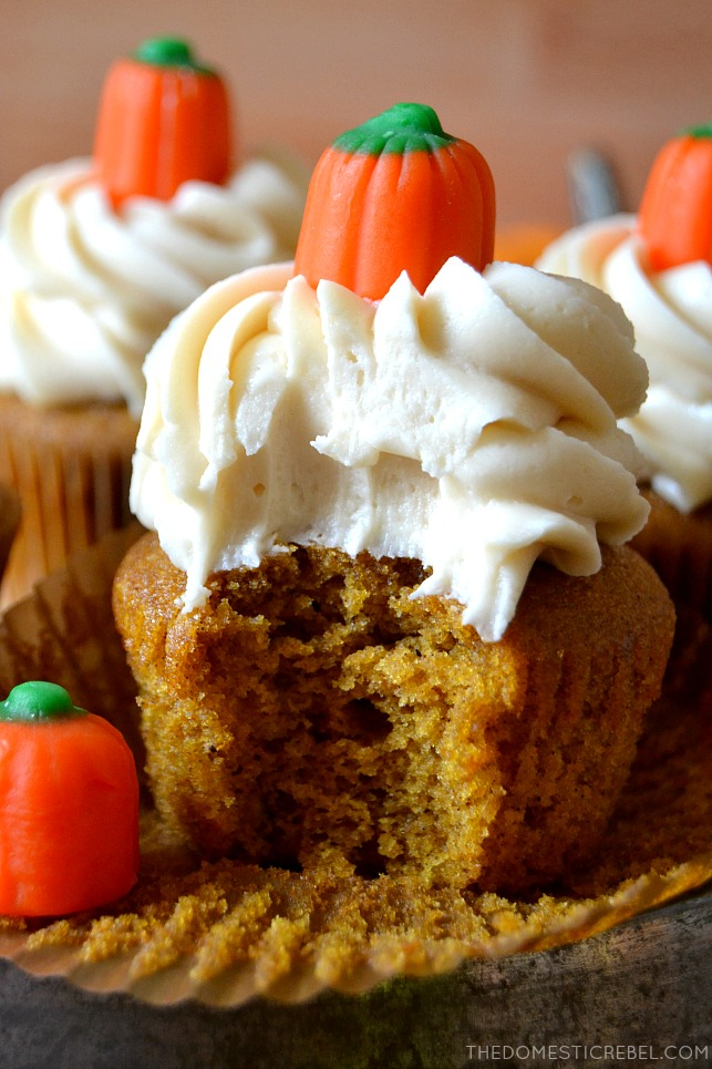 Closeup of pumpkin cupcake with bite missing