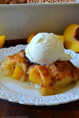 peach dumplings on plate with ice cream