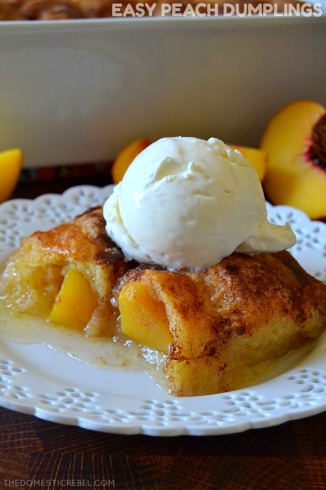 Easy Peach Dumplings on white plate with fresh peaches and ice cream