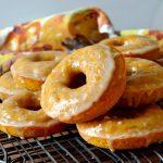 arangement of pumpkin donuts on wire rack