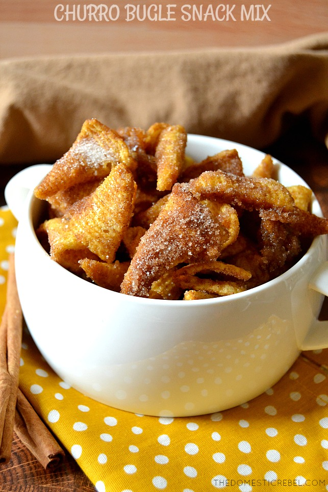 Churro Bugle Snack Mix in a white bowl on a yellow dotted napkin