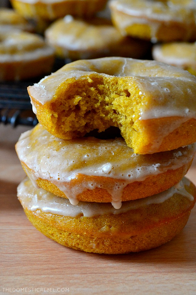 small stack of pumpkin donuts with a bite missing