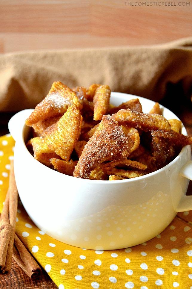 Churro Bugle Snack Mix in a white bowl on a yellow polka dot napkin
