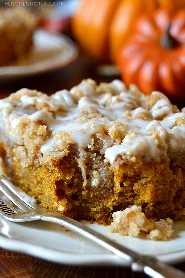 Close up of a piece of pumpkin coffee cake with a bite missing