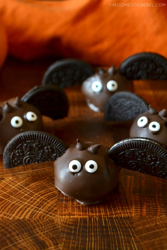 "Oreo ""bat"" balls on a wooden board"