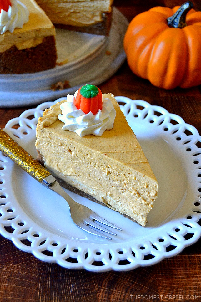 Slice of no-bake pumpkin cheesecake on a white plate with a gold fork