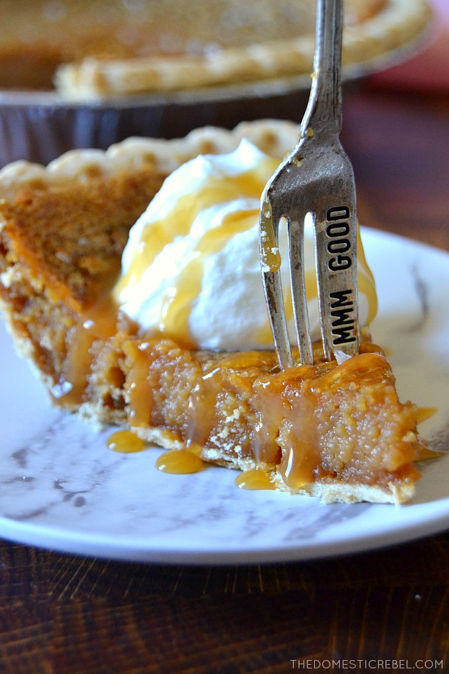 Closeup of a gooey salted caramel pie slice with a fork in it