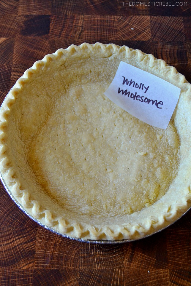 """Photo of pie crust on wood background """"wholly wholesome"""""""