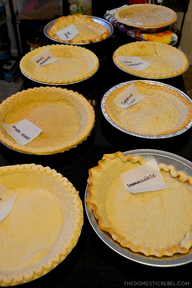 A bunch of pie crusts on a black table