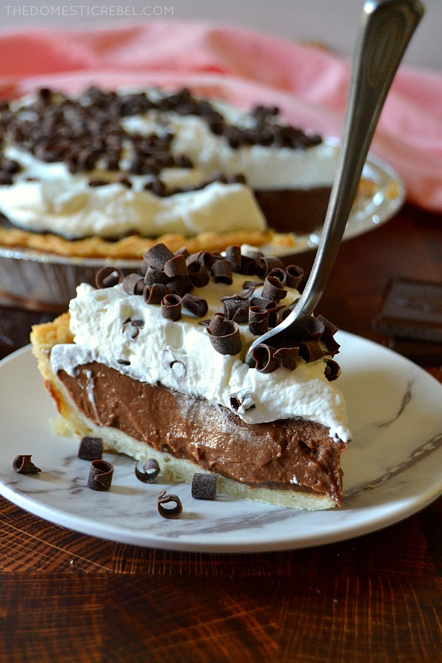 Slice of chocolate cream pie with a fork sticking in it