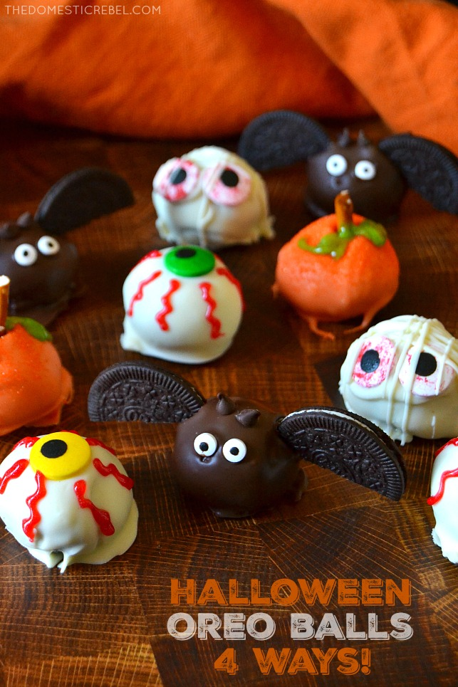 An assortment of Halloween-themed Oreo balls on a wooden board