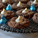 chocolate cookies and cream cookies on wire rack