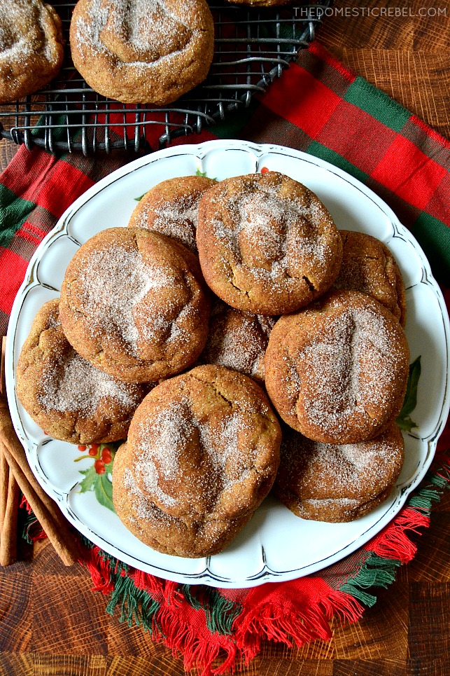 gingerdoodle cookies arranged on a white plate on top of a holiday napkin