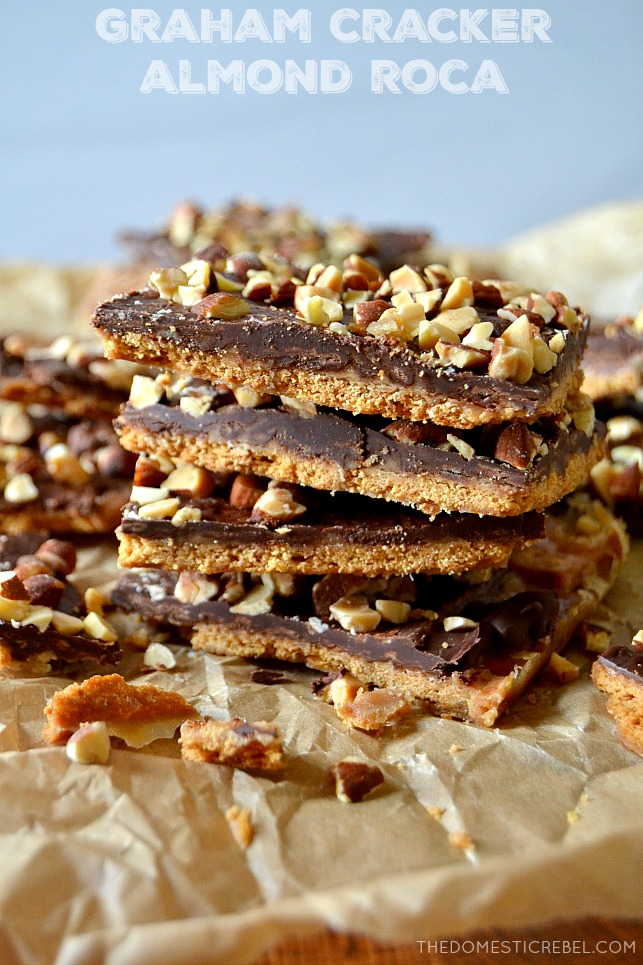 Small stack of 4 pieces of graham cracker almond roca toffee on parchment