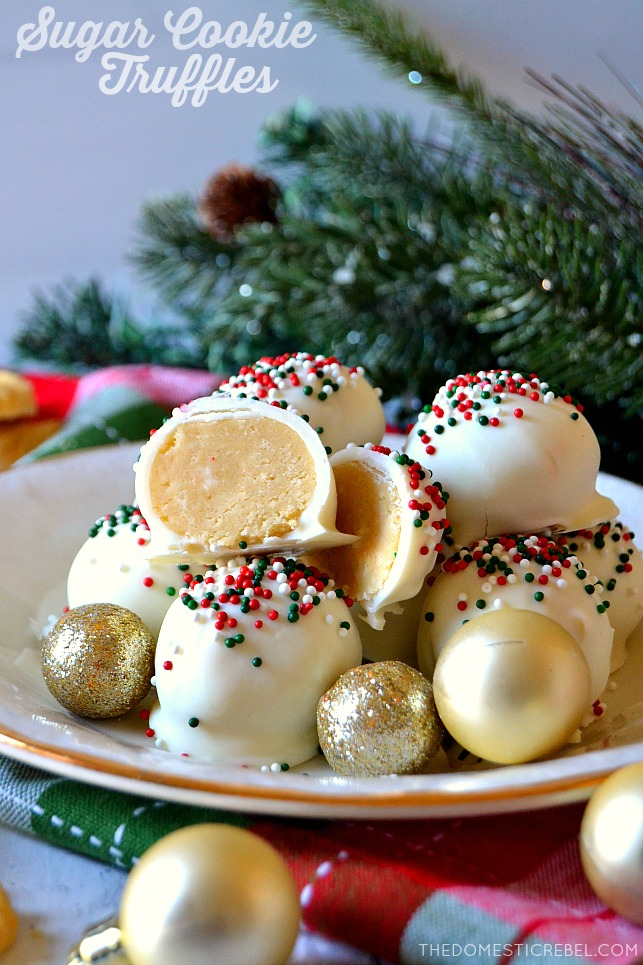 Small pile of sugar cookie truffles on white and gold plate with ornaments