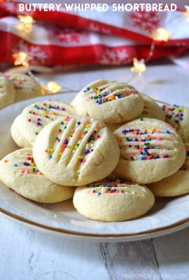 a white plate filled with whipped shortbread cookies