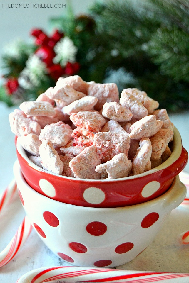 Red and white bowl of peppermint candy cane muddy buddies