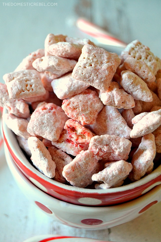 Closeup cluster of peppermint muddy buddies in a red bowl