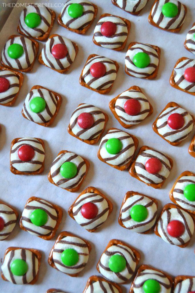 Baking sheet filled with Christmas pretzel hugs