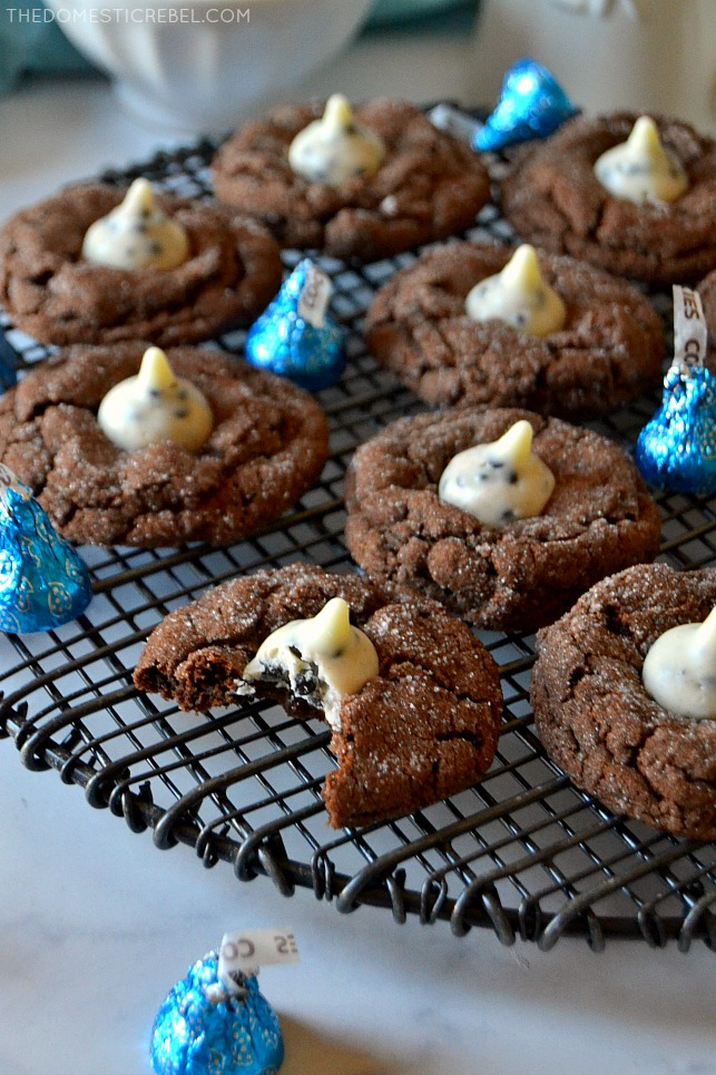 Chocolate cookies & cream cookies scattered on a black wire rack