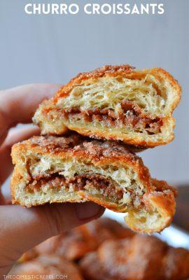 author holding a split open churro croissant