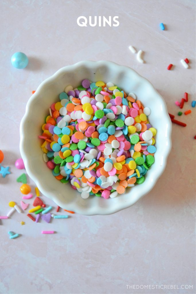 rainbow quin sprinkles in a small white bowl