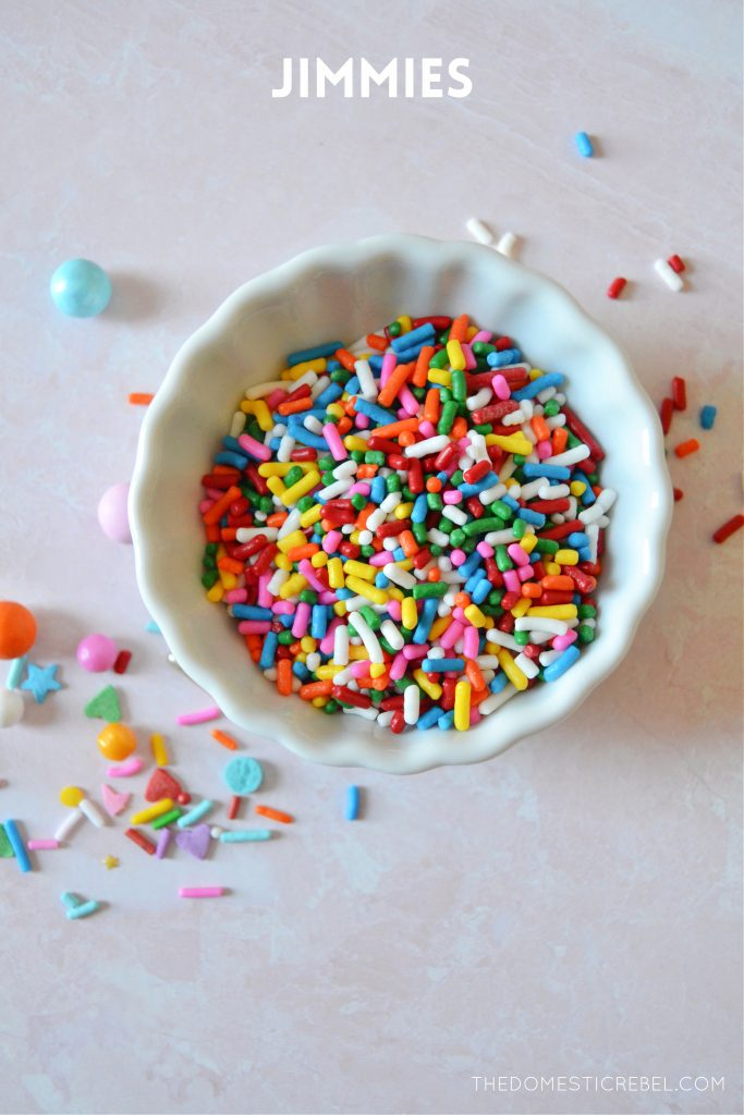 rainbow jimmies in a small white bowl