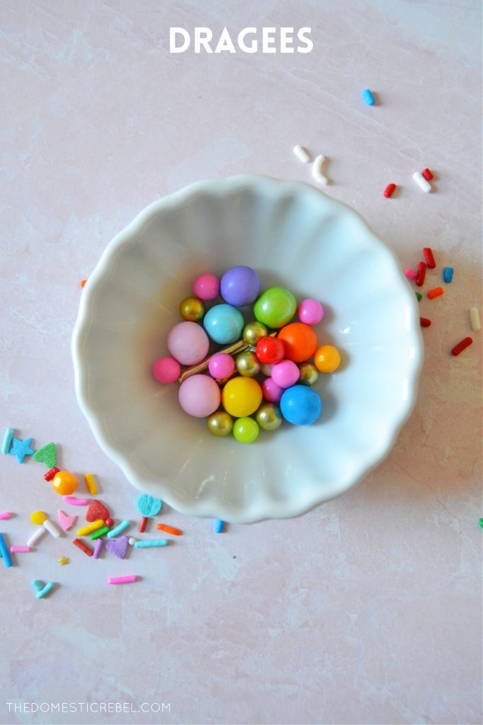 rainbow dragee sprinkles in a small white bowl