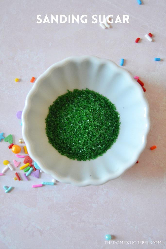 green sanding sugar in a small white bowl