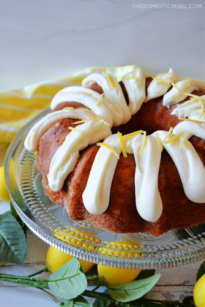 Lemon bundt cake on a glass cake plate