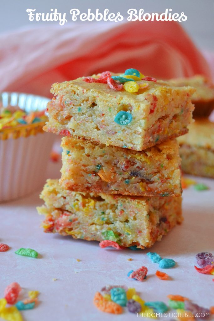 A trio stack of fruity pebbles blondies with pieces of cereal
