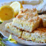 lemon crumble bars sitting on white plate