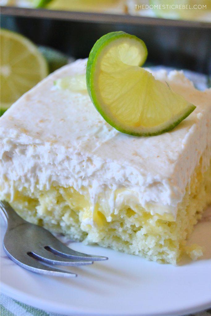 a closeup slice of a piece of key lime pie poke cake