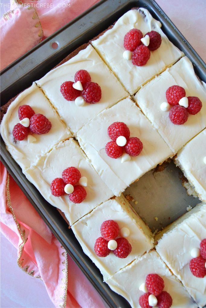 a pan of white chocolate raspberry cake slices