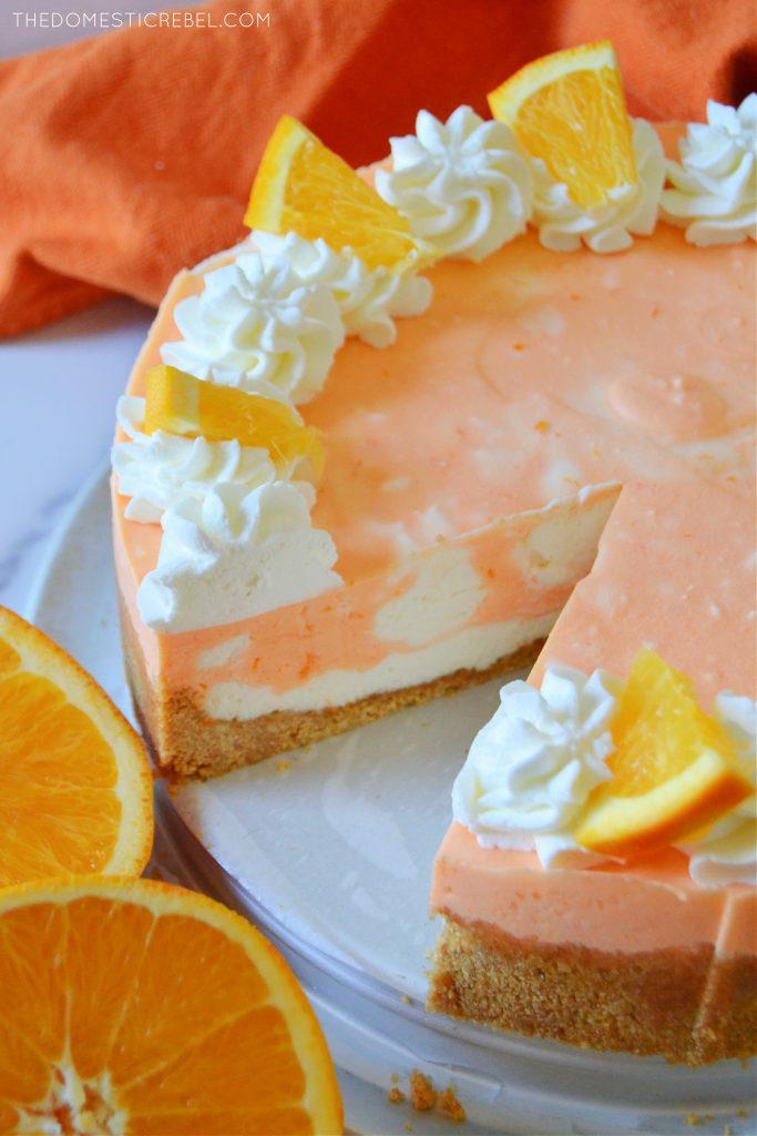 orange creamsicle cheesecake with orange halves