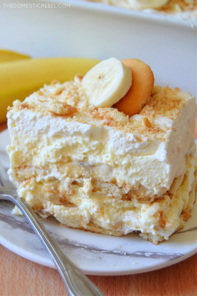 closeup slice of banana pudding on a white marble plate