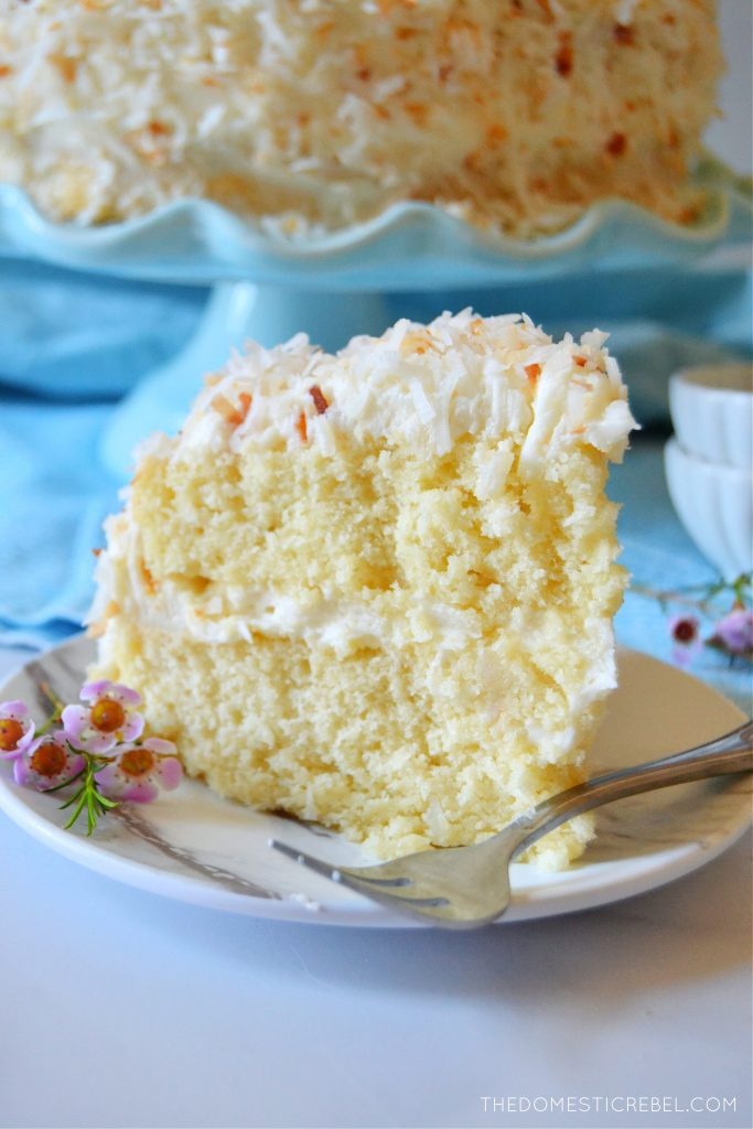 coconut layer cake with a fork on a plate